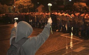 A demonstrator offers flowers to the riot police during an anti-government protest in Porto Alegre