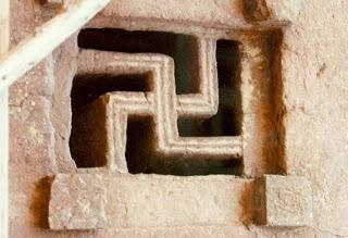 Skastika_symbol_in_the_window_of_Lalibela_Rock_hewn_churches