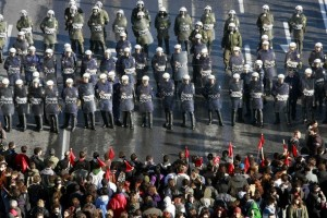 Protesters march towards formation of police officers outside parliament in central Athens