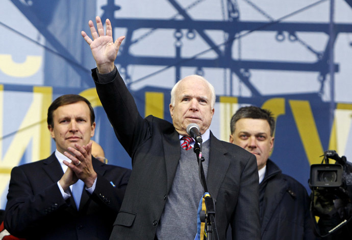 U.S. Senator McCain waves to pro-European integration protesters during a mass rally at Independence Square in Kiev